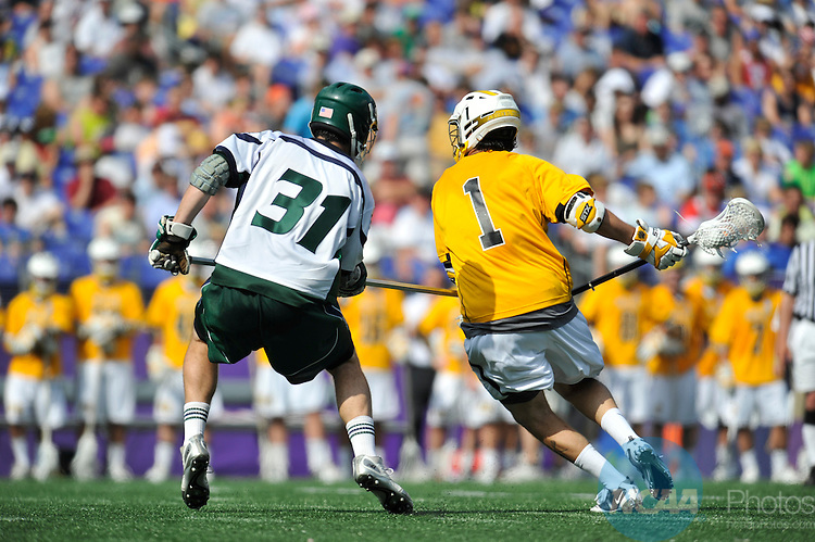 29 MAY 2011: Joe Vitale (1) of Adelphi University moves the ball against Matt Scherer (31) of Mercyhurst College during the Division II Men's Lacrosse Championship held at M+T Bank Stadium in Baltimore, MD.  Mercyhurst defeated Adelphi 9-8 for the national title. Larry French/NCAA Photos