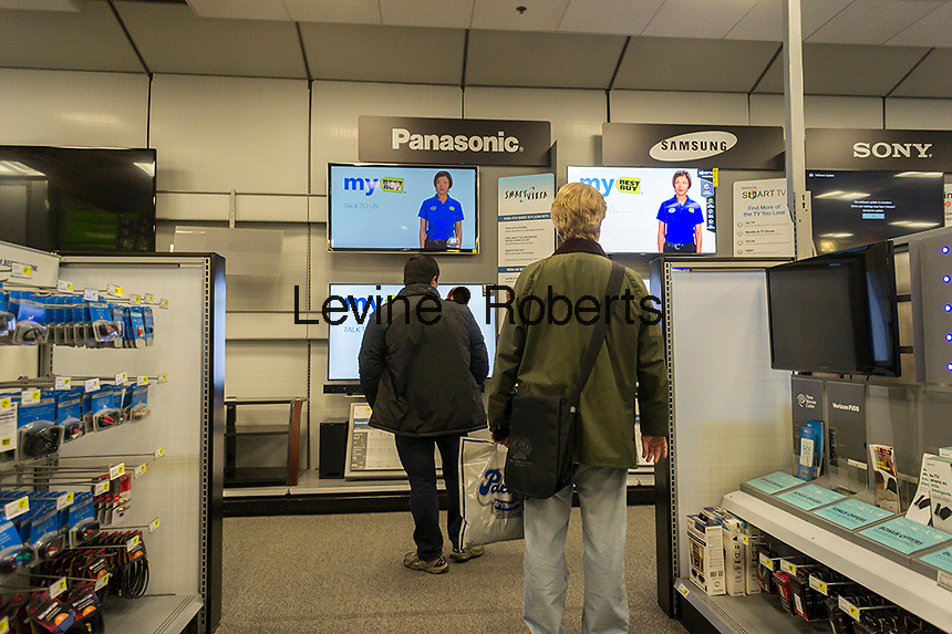 Flat-screen televisions on sale in a Best Buy electronics store in New York over the Black Friday weekend on Sunday, December 1, 2013. Retailers saw a 2.3% gain in sales over Thanksgiving and Black Friday with analysts predicting a small gain of only 2.4% over the entire 26 day season. (© Richard B. Levine)
