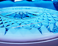 NEEDLE FLOATING ON WATER<br /> Surface tension, the pulling together of molecules on the surface of a liquid, allows the metal needle to float in spite of its greater density.