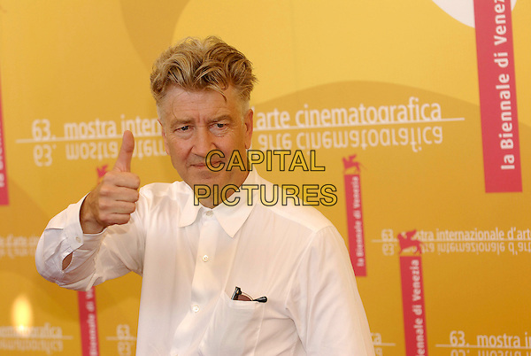 "DAVID LYNCH.Photocall for ""Inland Empire"".5th September 2006.63rd Venice International Film Festival, Italy.Ref: KRA.half length thumb up white shirt.www.capitalpictures.com.sales@capitalpictures.com.©Persun/Capital Pictures"