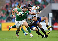 Cian Healy of Ireland takes on the Romania defence. Rugby World Cup Pool D match between Ireland and Romania on September 27, 2015 at Wembley Stadium in London, England. Photo by: Patrick Khachfe / Onside Images