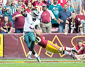 Philadelphia Eagles quarterback Vince Young (9) is pressured by Washington Redskins safety LaRon Landry (30) during the third quarter at FedEx Field in Landover, Maryland on Sunday, October 16, 2011.  The Eagles won the game 20 - 13.  The Eagles won the game 20 - 13..Credit: Ron Sachs / CNP