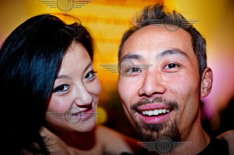 Ben Chong and Ella Meng at a nighclub.