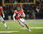Ole Miss quarterback Bo Wallace (14) rushes vs. Mississippi State at Vaught-Hemingway Stadium in Oxford, Miss. on Saturday, November 24, 2012. Ole Miss won 41-24.