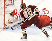 Kieran Millan (BU - 31), Paul Carey (BC - 22) - The visiting Boston College Eagles defeated the Boston University Terriers 3-2 to sweep their Hockey East series on Friday, January 21, 2011, at Agganis Arena in Boston, Massachusetts.
