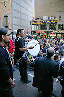 Man bangs drums at the Occupy Wall Street Protest in New York City October 6, 2011.