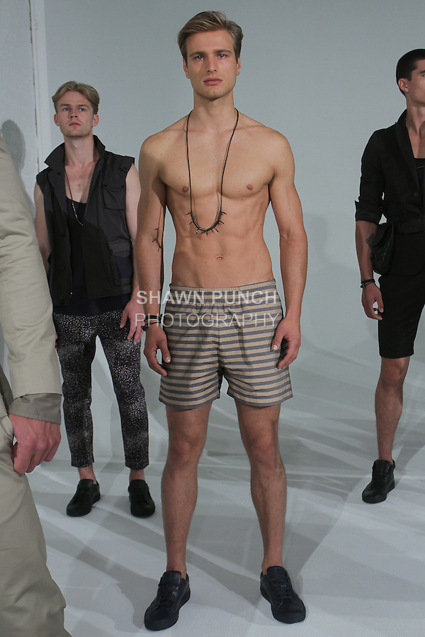 "Model poses in an outfit from the Cadet Spring Summer 2016 ""The Filthy 13"" collection by Raul Arevalo and Brad Schmidt, at New York Men's Day, during New York Fashion Week Men Spring Summer 2016."