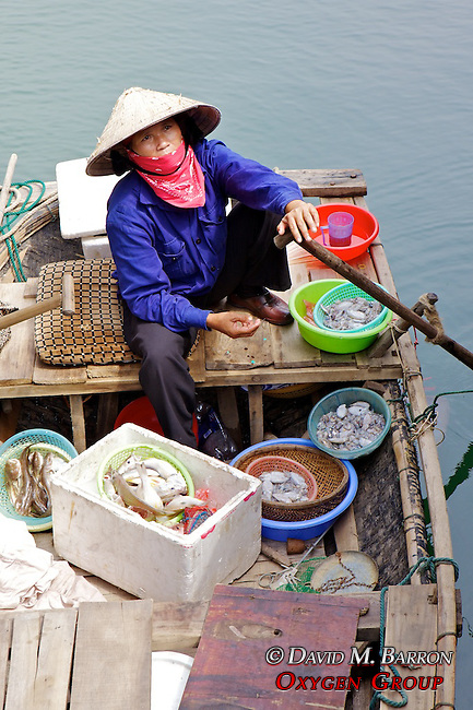Woman With Seafood For Sale