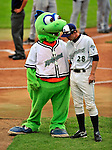 "22 June 2009: Vermont Lake Monsters' catcher Rick Nolan has a word with mascot ""Champ"" prior to a game against the Tri-City ValleyCats at Historic Centennial Field in Burlington, Vermont. The Lake Monsters defeated the visiting ValleyCats 5-4 in extra innings. Mandatory Photo Credit: Ed Wolfstein Photo"