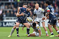 Rob Webber of Sale Sharks offloads the ball after being tackled. Aviva Premiership match, between Sale Sharks and Bath Rugby on May 6, 2017 at the AJ Bell Stadium in Manchester, England. Photo by: Patrick Khachfe / Onside Images
