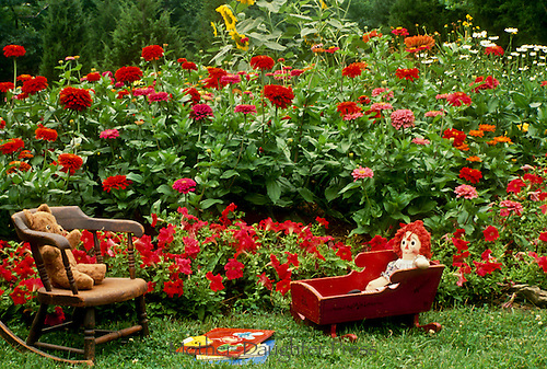 Playing in grandma's garden, antique toys and furniture serve well for play