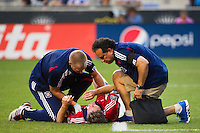 Chicago Fire trainers check on Logan Pause (12). The Chicago Fire defeated the Philadelphia Union 3-1 during a Major League Soccer (MLS) match at PPL Park in Chester, PA, on August 12, 2012.
