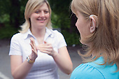 Women using sign language at The Nottinghamshire Deaf Society.  MR