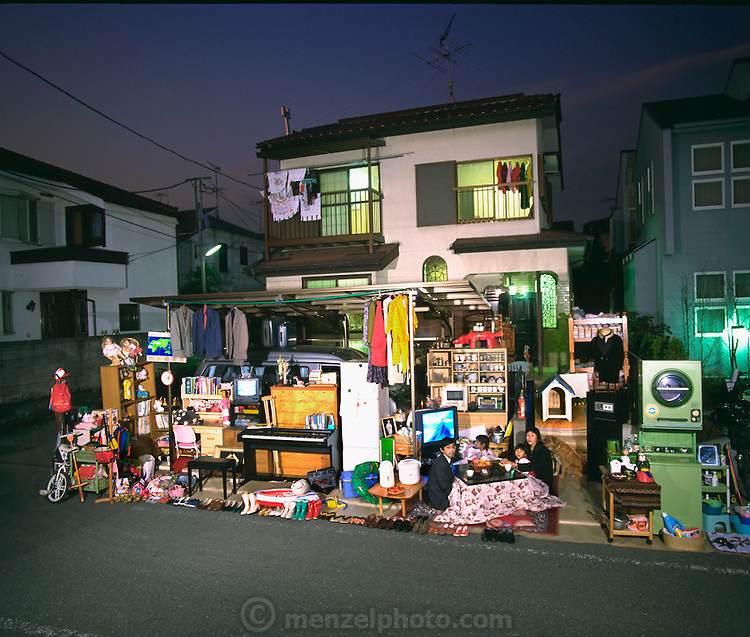 The Ukita Family in front of their home with all of their possessions, Tokyo, Japan. Published in Material World: A Global Family Portrait, page 48-49.