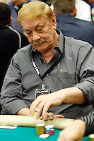 3 March 2007: NBA owner Dr. Jerry Buss playing a poker hand in action during the fifth annual WPT Invitational at the Commerce Casino in Los Angeles, CA.