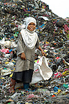 Children working in the municipal dump in Manila, the capital of the Philippines. Children and their parents work day and night in the dump, scavenging for items of value, including plastic, glass and metal, that can be recycled....