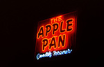 Apple Pan neon sign in lit up at night