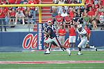 Ole Miss' Jeff Scott (3) runs against Southern Illinois' Blair Lane (43) at Vaught-Hemingway Stadium in Oxford, Miss. on Saturday, September 10, 2011. Ole Miss won 42-24.