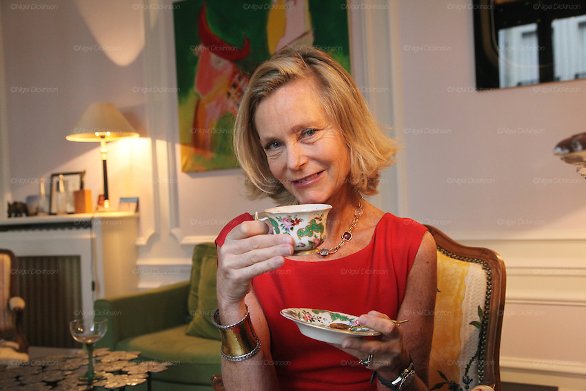 Marie de Tilly poses with a cup and saucer of tea in her apartment..Marie de Tilly gives lessons on French Etiquette. She lives in a bijou Hausman apartment in central Paris, not far from the Champs Elys&eacute;es. She has trained people with these skills for several years; working across the Paris area and even takes her work worldwide, giving classes to a range of people. She is especially popular in Russia and the ex-Soviet countries such as Kasakhstan. Her skills are sought after by individuals, families and businessmen wishing to aspire to enter French High Society. Her students, whether they are Russian or French, want to learn the necessary airs and graces to blend seemlessly into Parisian haute societ&eacute;. Paris, France