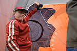 A boy holds a hot air balloon open for inflation at the 2008 Shenandoah Valley Hot Air Balloon Festival at Historic Long Branch in Millwood, Virginia.