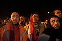 Egyptian protesters react with with a stunned disbelief February 10, 2011 as they watch a televised speech by President Hosni Mubarak on a screen in Tahrir Square  in Cairo, Egypt. Mubarak conceded only some powers to Vice President Omar Suleiman yet refused to concede the title of President and will remain in charge of transition towards democratic reforms, upsetting the crowd which had expected a full resignation. .Slug: Egypt.Credit: Scott Nelson for the New York Times