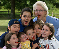 Grandmother with seven grandchildren eating popsicles.