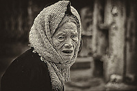 A rather elderly woman on the streets of Hanoi revealing her blackened teeth from eating betel nut over the years.