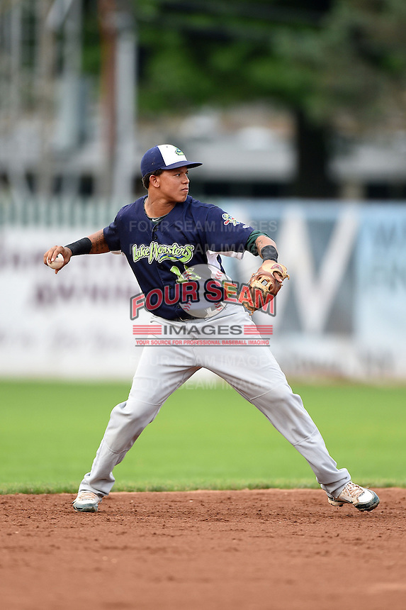Vermont Lake Monsters shortstop Yairo Munoz (15) throws to first during a game against the Jamestown Jammers on July 12, 2014 at Russell Diethrick Park in Jamestown, New York.  Jamestown defeated Vermont 3-2.  (Mike Janes/Four Seam Images)