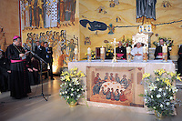 Pope Benedict XVI, prays in the Regina Pacis center's Church, in Amman, Friday, May 8, 2009. .