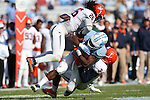 24 October 2015: UNC's Elijah Hood (34) is tackled by Virginia's Quin Blanding (3) and Maurice Canady (26). The University of North Carolina Tar Heels hosted the University of Virginia Cavaliers at Kenan Memorial Stadium in Chapel Hill, North Carolina in a 2015 NCAA Division I College Football game. UNC won the game 26-13.