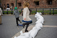 "Tourists step over sandbags at the Liberty Island ferry in Battery Park in the Zone A evacuation zone  prior to Hurricane Sandy, in New York on Sunday, October 28, 2012. In advance of the arrival of Hurricane Sandy New York will shut down the subways at 7 PM on Sunday and evacuate low lying ""Zone A"" areas including Battery Park City. In addition the schools will be closed on Monday. (© Frances M. Roberts)"