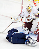 Jeff Dimmen (Maine - 6) reinjured his ankle at the start of the second period. - The Boston College Eagles defeated the visiting University of Maine Black Bears 4-0 on Friday, November 19, 2010, at Conte Forum in Chestnut Hill, Massachusetts.