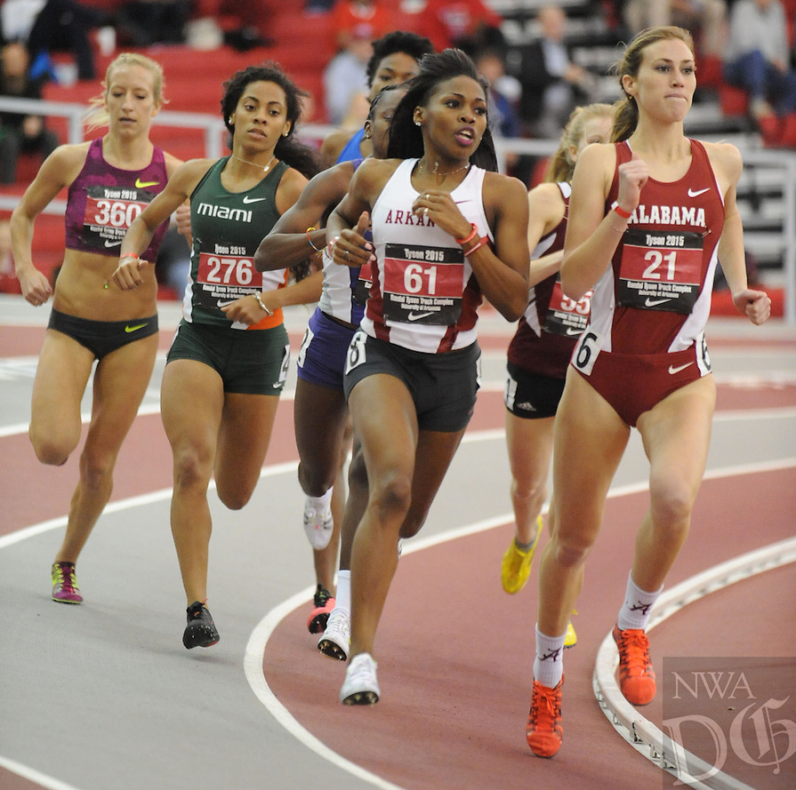 NWA Democrat-Gazette/ANDY SHUPE - Chrishuna Williams (61) of Arkansas leads the field while competing in the 800 meters during the Tyson Invitational Friday, Feb. 13, 2015, at the Randal Tyson Track Center in Fayetteville.