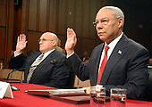 Washington, D.C. - March 23, 2004 -- United States Secretary of State Colin L. Powell, right and United States Deputy Secretary of State Richard L. Armitage, left, are sworn to testify before the hearing of the National Commission on Terrorist Attacks Upon the United States in Washington, DC on March 23, 2004.<br /> Credit: Ron Sachs / CNP<br /> [RESTRICTION: No New York Metro or other Newspapers within a 75 mile radius of New York City]