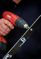 Battery powered hand drill in action. <br />