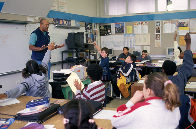 Berkeley CA 5th grade African American male teacher engaging students in lively discussion in class