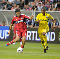 Chicago midfielder Sebastian Grazzini (10) passes the ball while being pursued by Columbus midfielder Kevan George (37).  The Chicago Fire defeated the Columbus Crew 2-1 at Toyota Park in Bridgeview, IL on June 23, 2012.