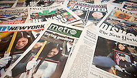 A collection of New York newspapers over several weeks, seen on Monday, January 5, 2015, report on the assassination of NYPD officers Rafael Ramos and Wenjian Liu who were murdered in Brooklyn in their squad car on December 20, 2014 by Ismaaiyl Brinsley allegedly in retaliation for the Eric Garner death. Brinsley killed himself in the subway during his attempted escape. (© Richard B. Levine)
