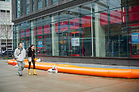 Inflatable barriers used to protect a building from flood damage seen in the Tribeca neighborhood in New York on Tuesday, October 30, 2012. Hurricane Sandy roared into New York disrupting the transit system and causing widespread power outages. Con Edison is estimating it will take four days to get electricity back to Lower Manhattan.  (© Frances M. Roberts)