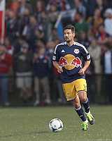 New York Red Bulls defender Heath Pearce (3) brings the ball forward.  2013 Lamar Hunt U.S Open Cup fourth round, New England Revolution (white) defeated New York Red Bulls (blue/yellow), 4-2, at Harvard University's Soldiers Field Soccer Stadium on June 12, 2013.