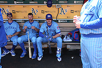 OAKLAND, CA - AUGUST 6:  Kris Bryant #17 of the Chicago Cubs gets ready in the dugout before the game against the Oakland Athletics at the Oakland Coliseum on Saturday, August 6, 2016 in Oakland, California. Photo by Brad Mangin