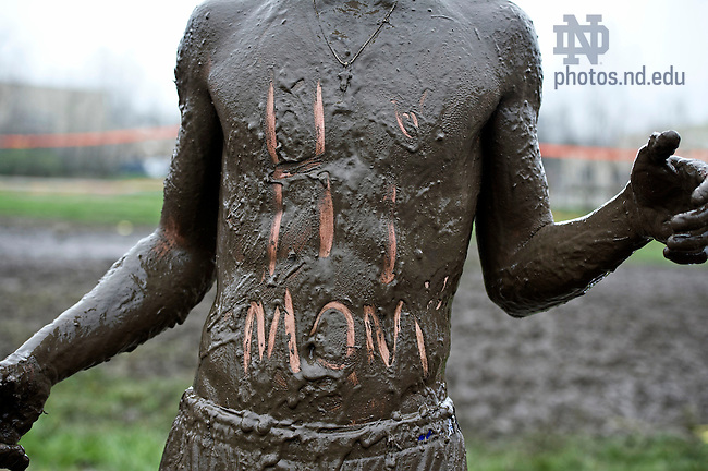 April 28, 2013; Mechanical engineer student, Jonathan Cernanec writes a message to mom during Muddy Sunday's charity event. Photo by Barbara Johnston/University of Notre Dame