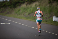 Mirinda Carfrae on a blistering pace on the run at the 2013 Ironman World Championship in Kailua-Kona, Hawaii on October 12, 2013.