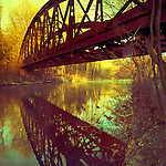 Abandoned bridge of river Wupper, Germany. Texturized photograph.<br />