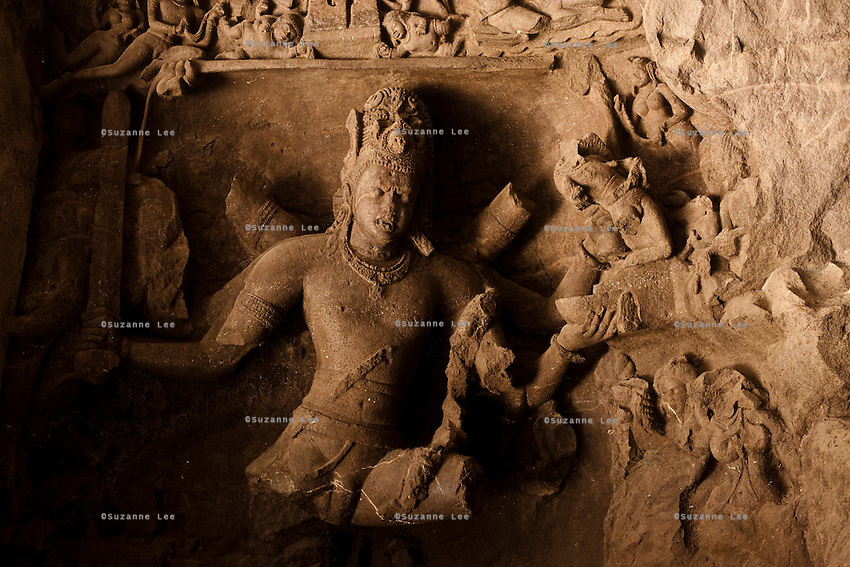 Statue carvings in the Elephanta Caves, a Hindu place of worship for the Lord Shiva, accessible by a long ferry ride in the Arabian sea, Mumbai, India. Photo by Suzanne Lee