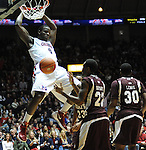 Mississippi's Demarco Cox (4) dunks vs. Mississippi State at the C.M. &quot;Tad&quot; Smith Coliseum in Oxford, Miss. on Wednesday, January 18, 2012. Mississippi won 75-68. (AP Photo/Oxford Eagle, Bruce Newman).