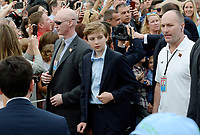 Barron Trump attends the annual Easter Egg roll on the South Lawn of the White House in Washington, DC, on April 17, 2017. <br /> CAP/MPI/CNP/RS<br /> &copy;RS/CNP/MPI/Capital Pictures