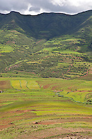 28 January 2011, on the road to Katse Dam, Lesotho. Farmland appear as patches on the gentler slopes of the Maloti Mountains.