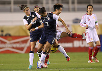 BOCA RATON, FL - DECEMBER 15, 2012: Carli Lloyd (10) and Shannon Boxx (7) of the USA WNT crash into Wang Chen (16) China WNT during an international friendly match at FAU Stadium, in Boca Raton, Florida, on Saturday, December 15, 2012. USA won 4-1.