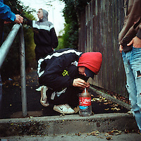 Youths in the Ballysillan area of North Belfast smoke marijuana 'buckets' in public using a bong made from a plastic bottle. Many of the young people loathe paramilitary groups such as the UDA (Ulster Defence Association, a loyalist paramilitary group) who now refuse to take on new recruits.